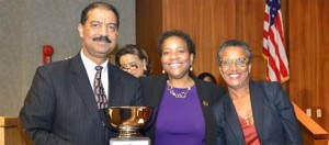 Karen E. Evans and Washington Bar Association present DC Court of Appeals Chief Judge Eric T. Washington with the Ollie May Cooper Award